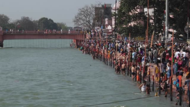 Thousands of devotees bathing at the sacred ghats of Ganges / Haridwar is an ancient city and important Hindu pilgrimage site where the River Ganges...