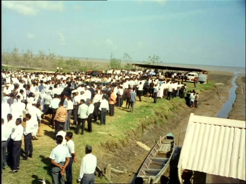 1969 Thousands of Hindus take part in a funeral procession, the mortal remains of a deceased man is burned on a funeral pyre / Paramaribo, Surinam