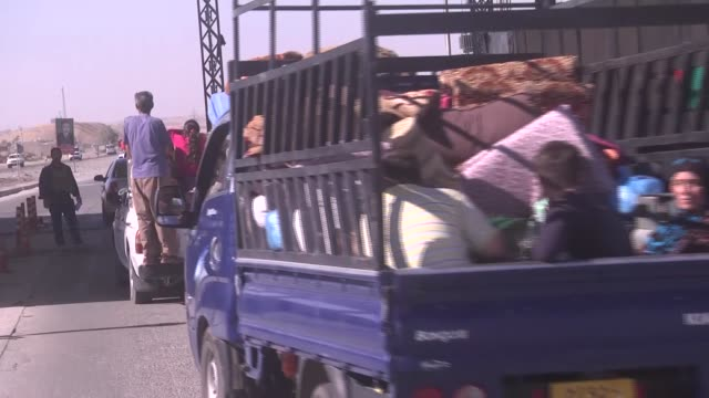 Thousands of Iraqi civilians who fled their homes the day before return back to Kirkuk after Iraqi government forces assumed 'full control' over...