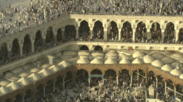 Thousands of Islamic pilgrims surge around the mosque in Mecca.