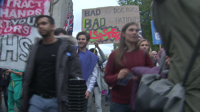 Thousands of junior doctors have marched through Westminster to protest against planned changes to their working contracts Association says the plans...