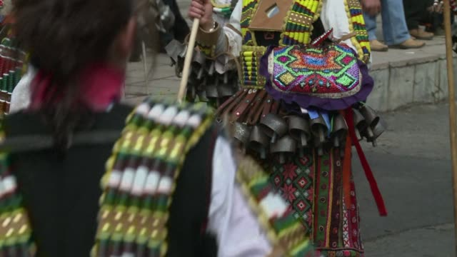 Thousands of masked dancers wearing loud bells gathered from villages around Bulgaria and abroad on Saturday for a traditional festival to scare away...