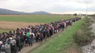 Thousands of migrants in Slovenia on Thursday walked from the temporary camp in Rigonce to another provisional location in the village of Dobova
