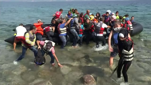 Thousands of migrants rescued by Italian Coastguard Warnings of increase in numbers DATE Refugees along in crowded dinghy and helped from boat...