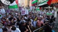 Thousands of people from different nations and religions gather at Times Square to protest the ongoing Israeli attacks in Gaza within the 'Operation...