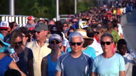 Thousands of people have formed a human chain on the streets of Charleston to pay tribute to the nine worshippers who died in the mass shooting...