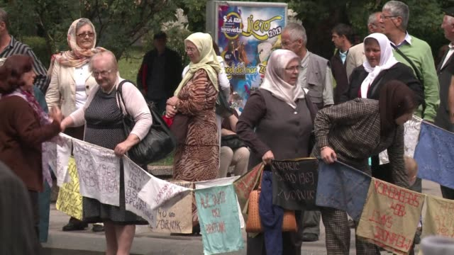 Thousands of people lined up Sarajevo avenues on Tuesday in a silent tribute to the remains of 409 victims of 1995 Srebrenica massacre passing in a...