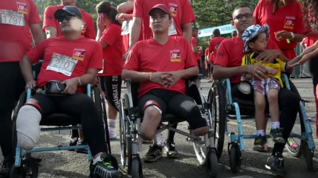 Thousands of people some of them victims of landmines took part Sunday in races in Medellin and Cali to raise awareness of the threat caused by these...