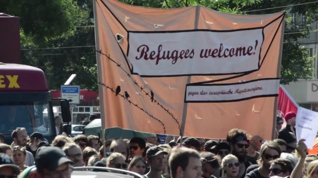 Thousands of people take to the streets of the German city of Dresden to welcome refugees according to an AFP journalist at the scene following a...