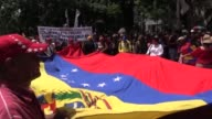 Thousands of progovernment demonstrators took to the streets of Caracas in a show of support for President Nicolas Maduro as opposition protesters...