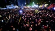 Thousands of protesters hold a candlelit rally in central Seoul denouncing South Korean President Park GeunHye over a highprofile corruption and...