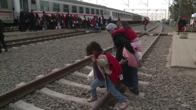 Thousands of refugees in Tovarnik on the Croatian border continued to board trains on Sunday headed for Slovenia