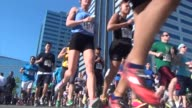 thousands of runners in race just pass starting line