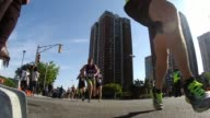 Thousands of runners in race leaders close to camera
