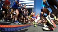 thousands of runners in race start shot low angle