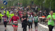 Thousands of runners took part in the 2014 Belfast Marathon Shows exterior shots of anonymous runners running along Falls Road in Belfast with mural...