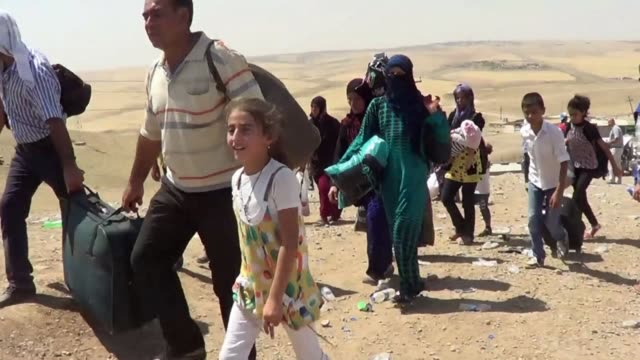 Thousands of Syrian Kurds have poured into Iraq over the past few days to escape deadly clashes between Kurdish fighters and jihadists and seeking a...