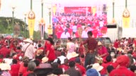 Thousands of Thai pro government Red Shirts massed Saturday in a show of support for Prime Minister Yingluck Shinawatra warning that they would...