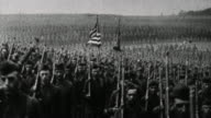 Thousands of US soldiers march past camera / France