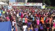 Thousands of women start running race in Albany NY a festive sports scene