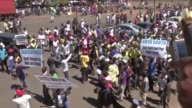 Thousands of Zimbabweans march through Harare in a show of support for first lady Grace Mugabe who has evaded assault allegations in South Africa by...