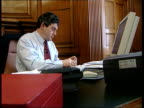 Threat of tax on savings LIB London Downing Street Number 11 INT Chancellor Gordon Brown MP working at desk