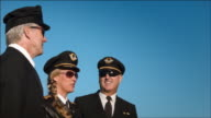 W/S three airline pilots watch as aircraft passes overhead: Air China Boeing-777