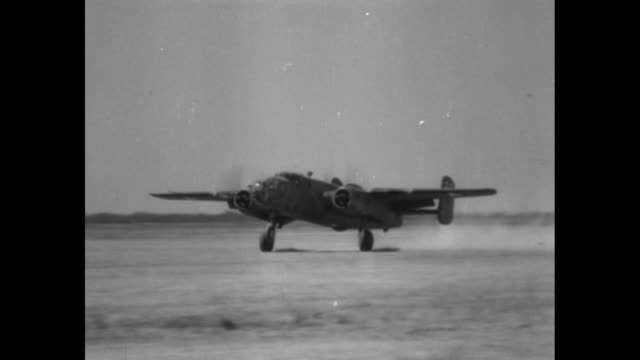 Three bombers overhead / VS landing gear wheel moves into position and touches down on runway / pan of plane landing / plane makes belly landing with...