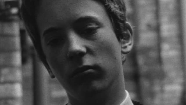 1976 B/W MONTAGE Three bullies corner a younger boy and strike him down / Liverpool, Merseyside, England