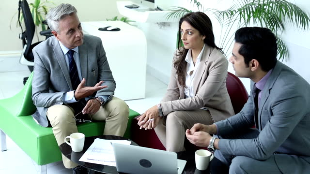 Three business people doing meeting in the office, Delhi, India