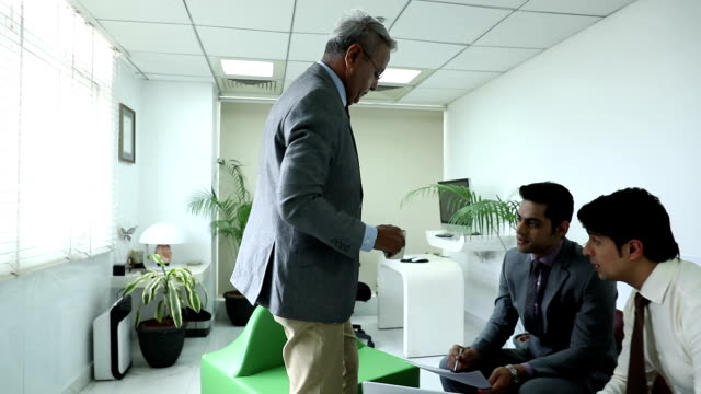 Three businessmen doing meeting in the office, Delhi, India