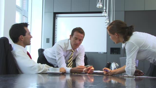 CU, Three businesspeople talking in meeting room
