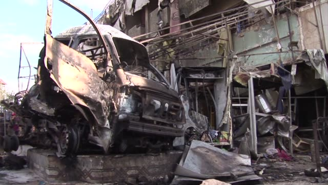 Three car bombs exploded in a Shiite area of northeast Baghdad on Tuesday killing at least 18 people Iraqi security and medical officials said