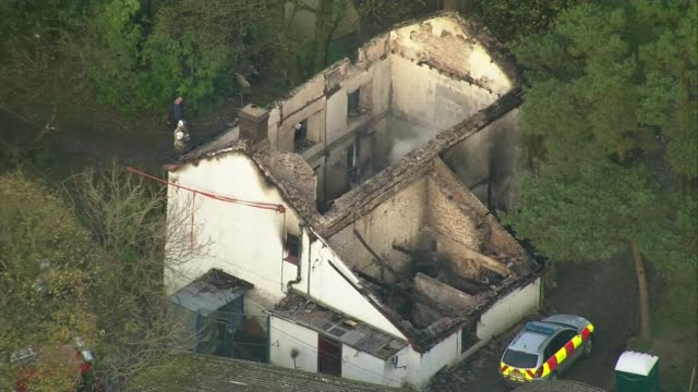 Three children in hospital and number of people feared dead after house fire in Powys WALES Powys Llangammarch Wells VIEWs / AERIALs burnout ruin of...