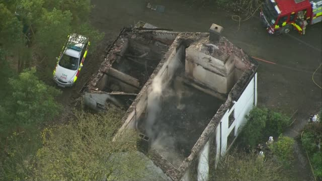 Three children in hospital and number of people feared dead after house fire in Powys Llangammarch Wells VIEWs / AERIALs burnout ruin of farm house...