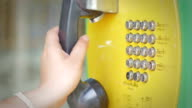 Three clips in one clip of using Public telephone,Close-up