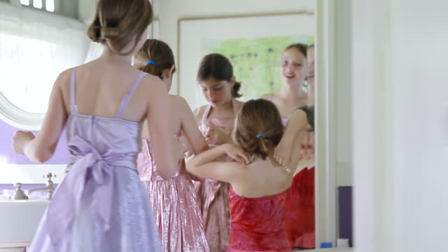 MS PAN TU TD Three cute girls playing dress up and  applying makeup / Pasadena, California, United States