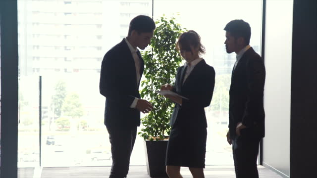 Three Entrepreneurs Briefing in the Office (slow motion)