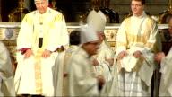 Three former Church of England bishops ordained as Catholic priests Broadhurst Burnham and Newton hugging other Catholic priests on altar Broadhurst...