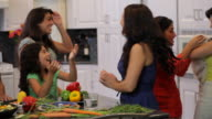 MS PAN Three generations cooking together in home kitchen / East Hanover, New Jersey, United States