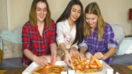 Three girlfriends eating pizza