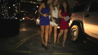 WS TS Three girls exit Limo and walk past camera.Mayfair