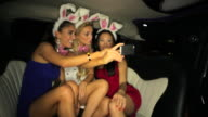 WS Three girls in Bunny ears taking picture in Limousine