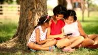 three girls reading book
