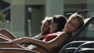 three girls sunbathing