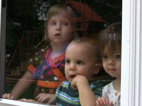 Three Kids looking through glass with rain NTSC