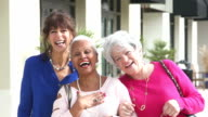 Three multi-ethnic senior women on city sidewalk
