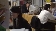 MS, Three people working in office