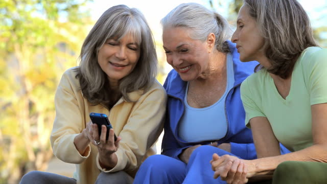 MS Three senior women looking at smartphone / Los Angeles, California, USA