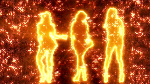 Three sexy girls dancing in silhouette on disco background orange